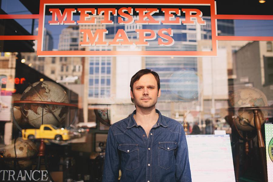 guy portrait in front of metsker maps seattle